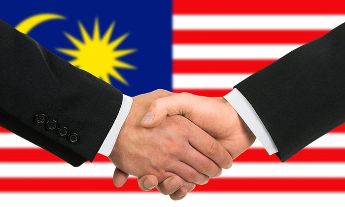 akankashad-dec2014-malaysian-handshake-shutterstock